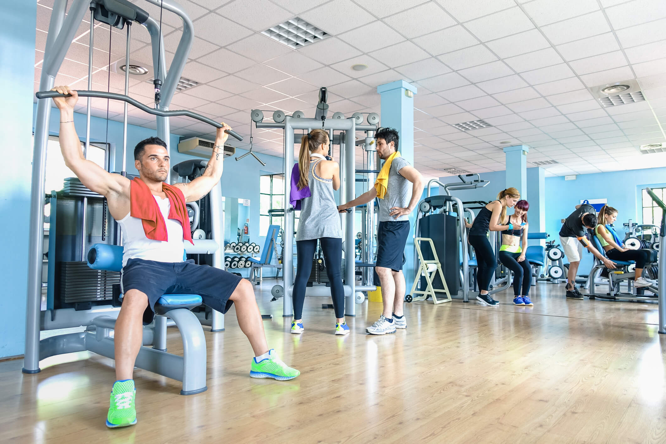 people working out inside of a gym