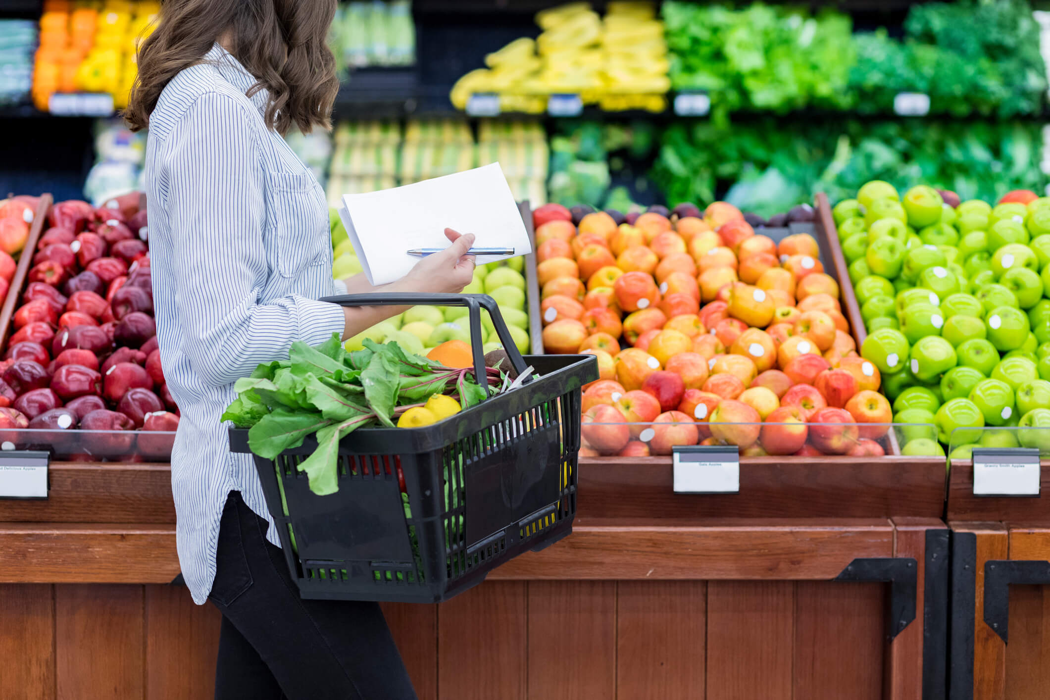 woman grocery shopping with basket