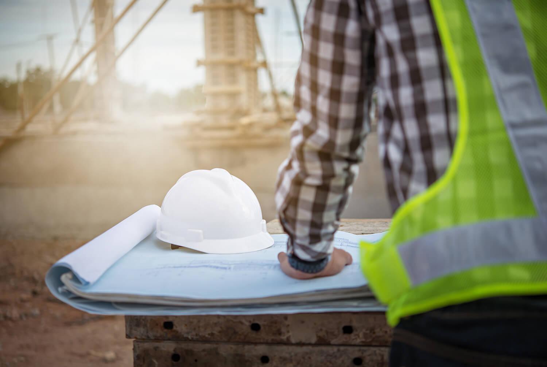 Construction Worker Reviews Site Plans