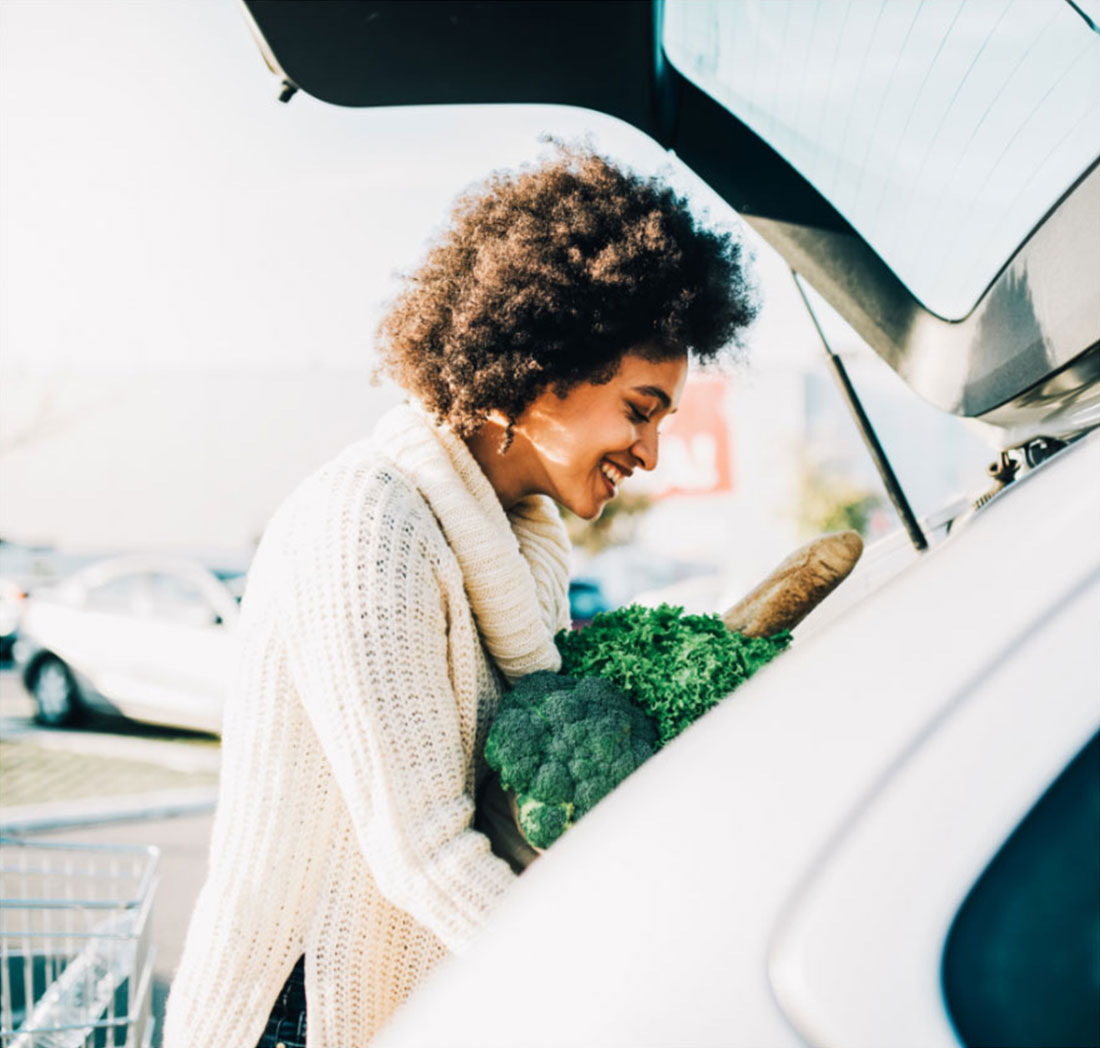 Woman Putting Groceries in Her Car